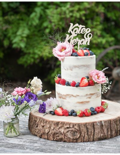 Two Tier Semi Naked Cake with Fruit / Blooms / Topper - The Green Weddings In Cornwall