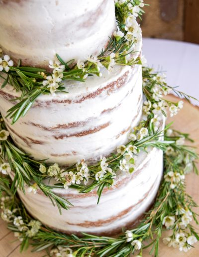 Semi Naked cake dressed with aromatic floral garlands from Twigs & Greens - Trevenna Barns