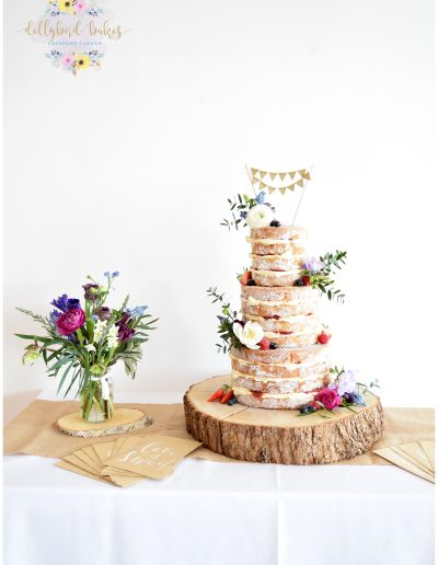 Rustic naked cake - Dressed with fresh fruit & flowers (The Flower Mill) - The Green Weddings In Cornwall