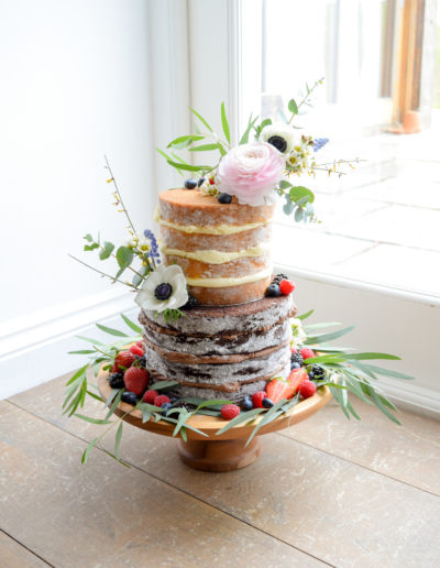Wild Naked Cake With Floral Accents & Berries At Tregulland