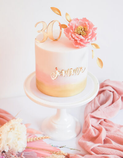 Beautiful 30th Birthday cake - finished in pink and gold watercolour dressed with a handcrafted sugar peony and 30 gold cake topper