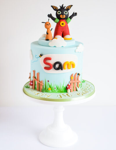 Bing inspired birthday cake with garden details and two handcrafted characters on top of the cake.