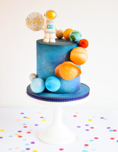 Space Themed cake - Featuring an astronaut, and the solar system.