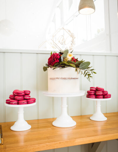 Single tier wedding with accompanying macarons - fresh floral accents.